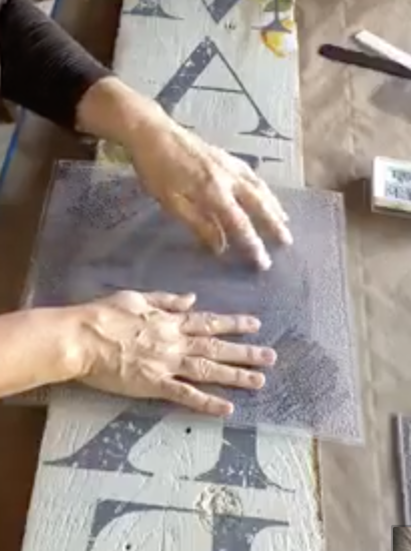 gently press the IOD craquelure stamp to create a crackle paint look